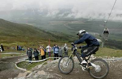 A downhill competitor on Nevis Range
