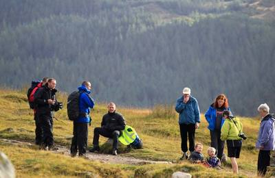 Walkers relaxing in Glen Nevis