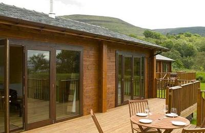 Log cabins with leisure decking